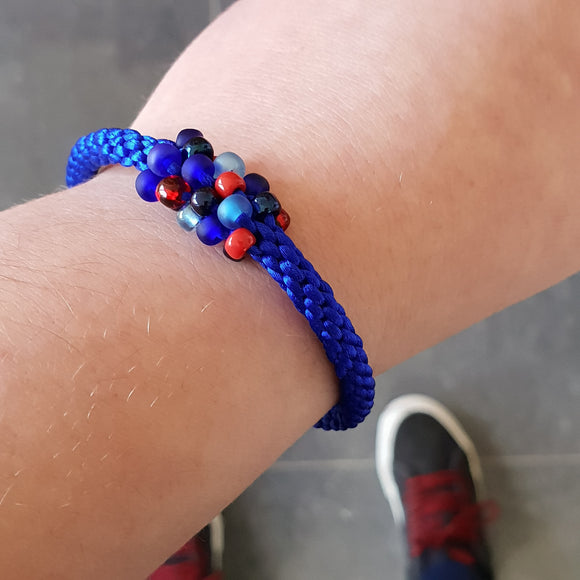 Braided Bracelet With Beads - Red and Blue on Azure Blue