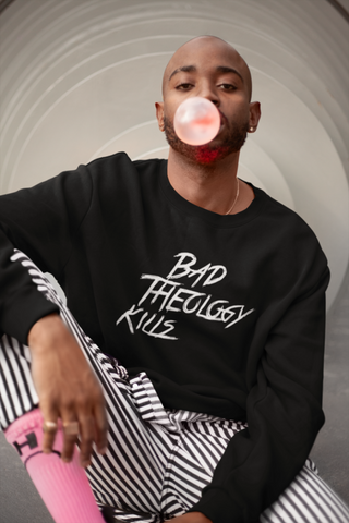 Man wearing Bad Theology Kills crewneck
