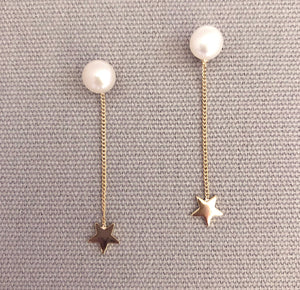 Gorgeous pearl earrings with star backing