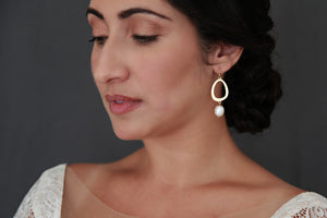 Gold circle and large pearl earrings