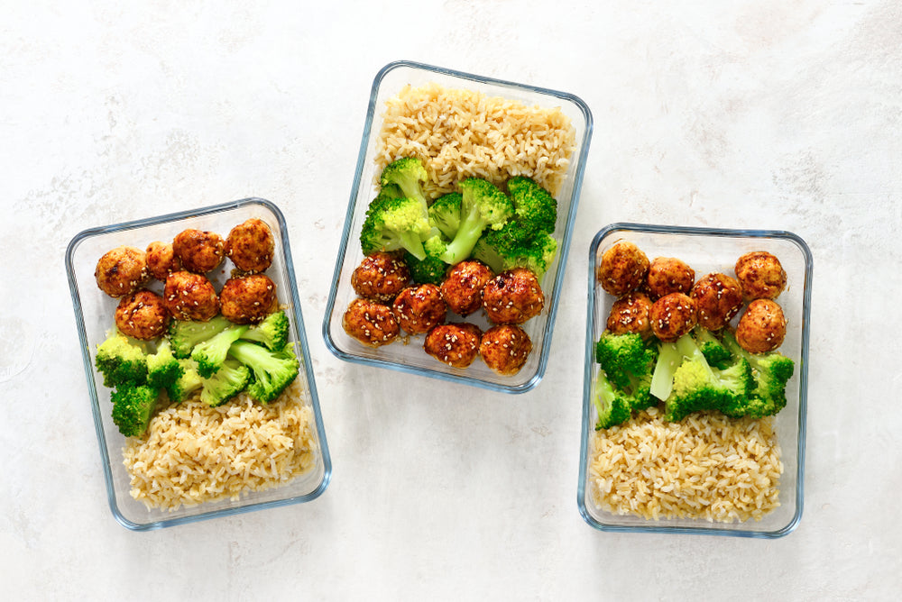 Meal prep containers and portioned meals