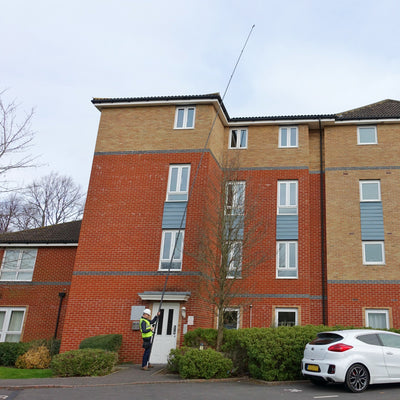 Single operator using a 52ft 15m five storey camera pole system for roof inspection, sold by Vantage Point Products