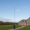 30ft 9m 10m carbon fibre photography camera mast with tripod being elevated outdoors