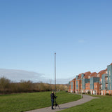 Vantage Point Products' 20ft 6m two storey camera mast for aerial imaging shown outdoors with a tripod