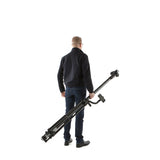Man holding Vantage Point Product's camera mast and tripod to show how portable it is