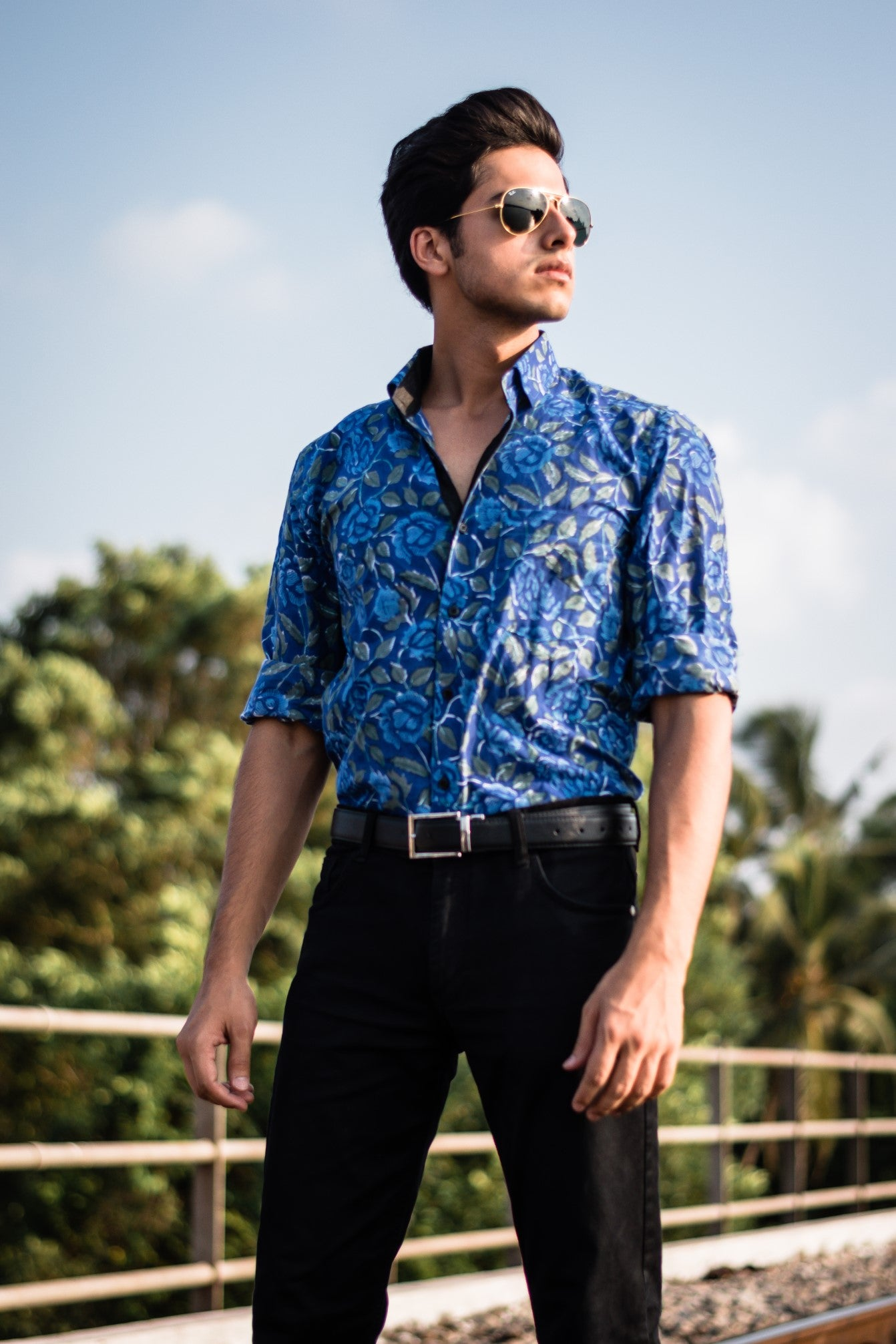 Deep blue with green petals printed shirt by Kaldern clothing designed for a grandeur look.