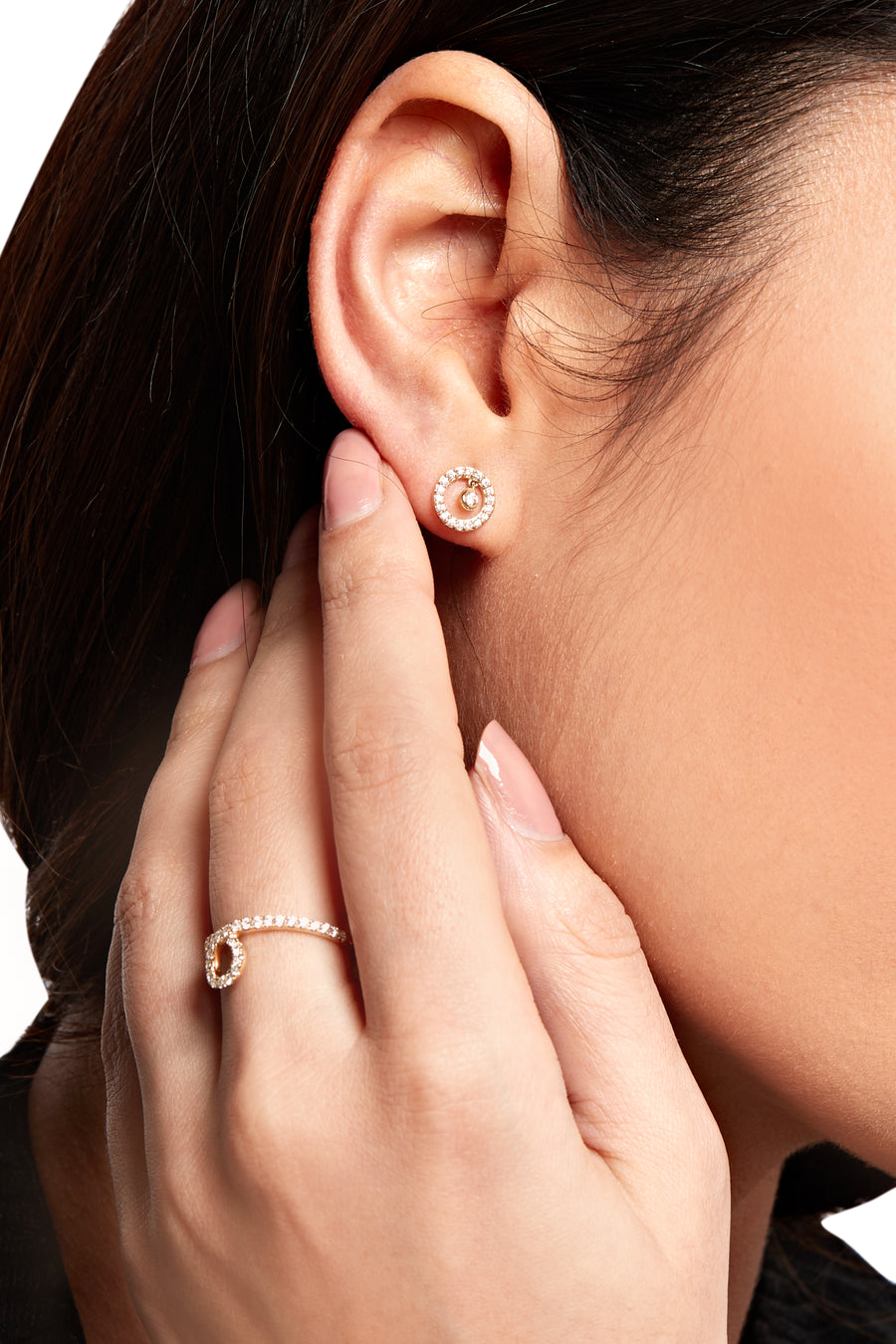 Model wearing Lark & Berry's Modernist Sun Shimmer Stud Earrings with 14K yellow gold and lab-created diamonds.