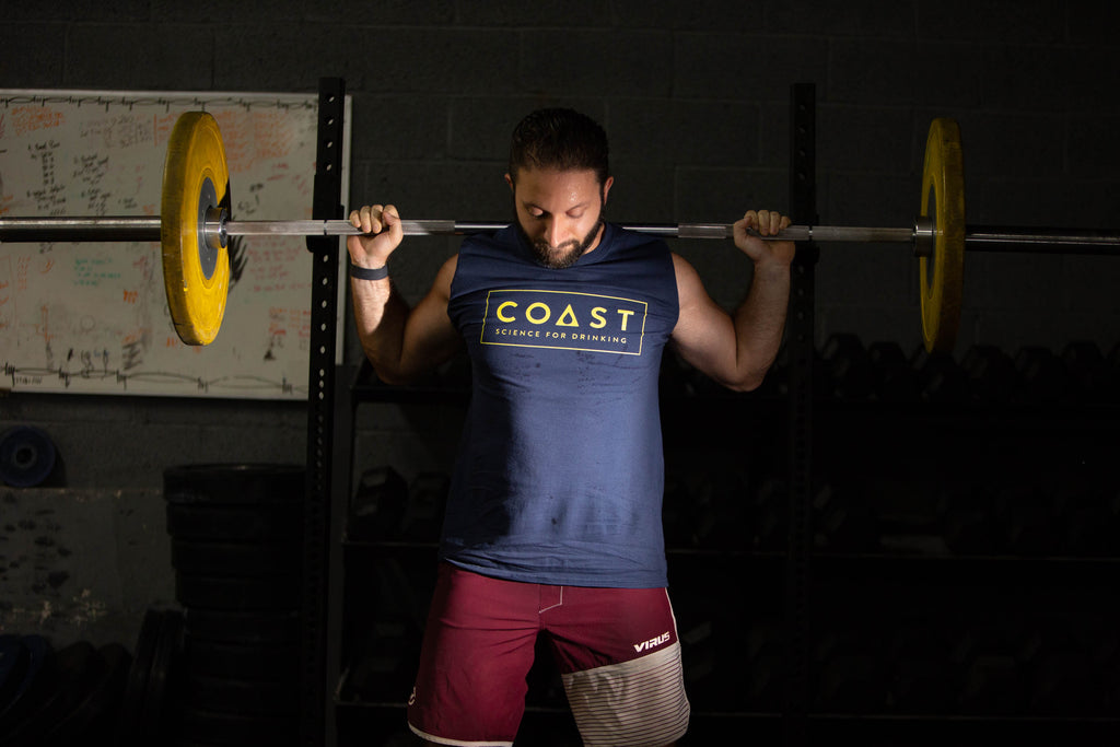 Man working out in Coast Science for Drinking shirt. Coast Drink (Coast Health) limits damage from drinking to physical performance/recovery and adds NAD+. Detox for workout recovery, muscle repair, endurance, metabolism, better sleep, NAD+.