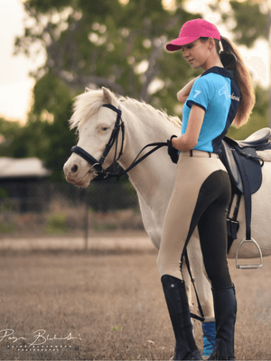 Lady in Beige Chocolate Slicker Sticker BREECHES standing beside Horse