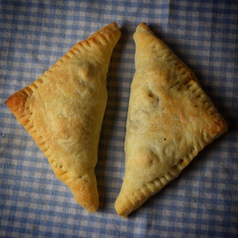 Garlicky Greens and Goat Cheese Hand Pies