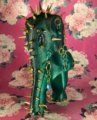 Waking Elephant: Translucent Green with Black. Gold Spikes and Such