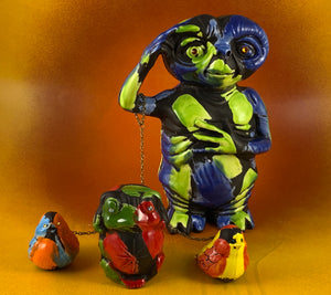 ET Chained to a Frog and Two Birds