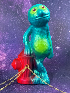 Grover Leaning on a Fire Hydrant Chained to Sports Turtles