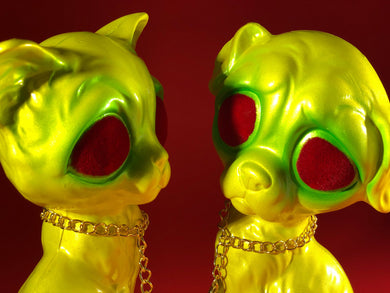 Sad dog, Sad cat chained together. Yellow and green with red flocked eyes
