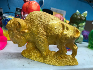 Seriously reflective bison, yellow and gold