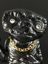 Load image into Gallery viewer, Black ET with rhinestone eyes, gold chain and metal flake