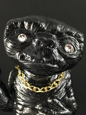 Black ET with rhinestone eyes, gold chain and metal flake