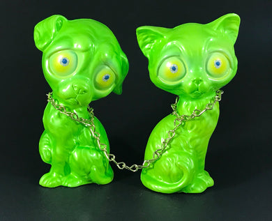 Chained sad dog and sad cat, iridescent green with metal flake/glitter eyes