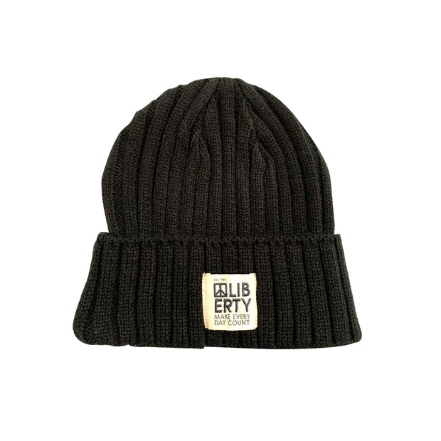 Black heavy knit beanie with label