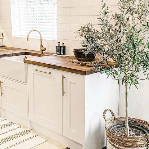 Update your kitchen cabinets with gold hardware