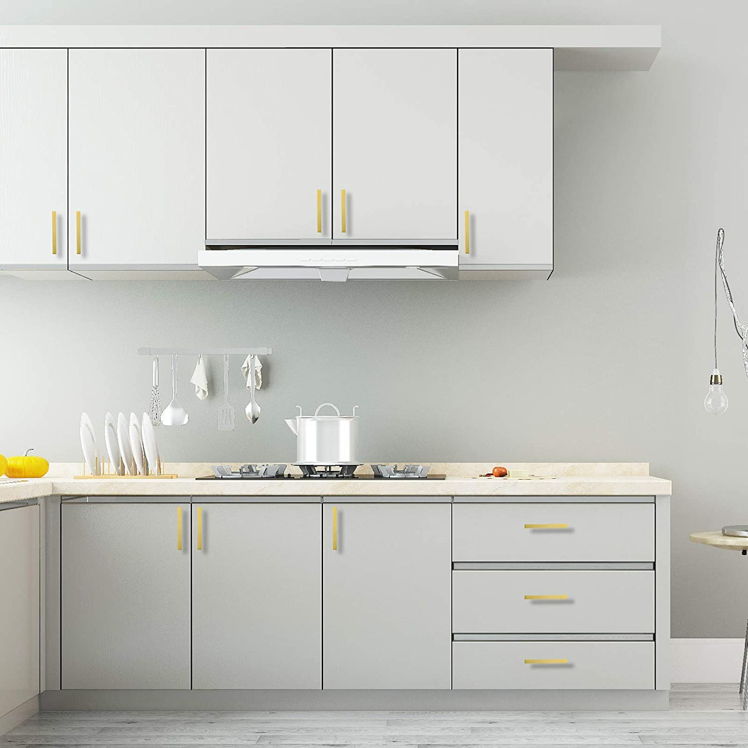 white cabinets with gold pulls