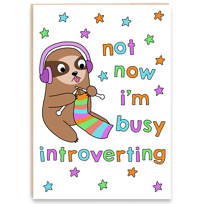 Introvert greeting card featuring an illustration of a cute sloth knitting and says not now i'm busy introverting.