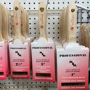 professional paint brushes hanging up