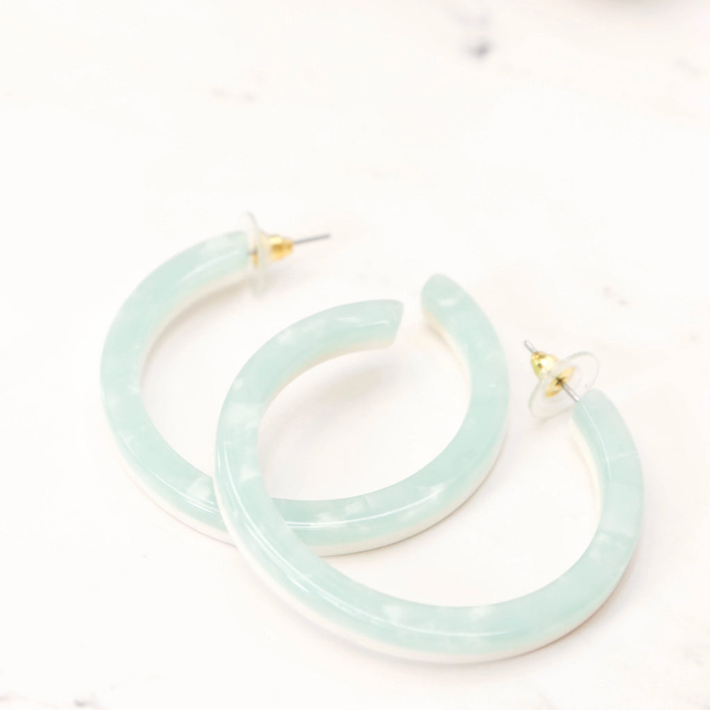 Teal and ivory acrylic hoop earrings