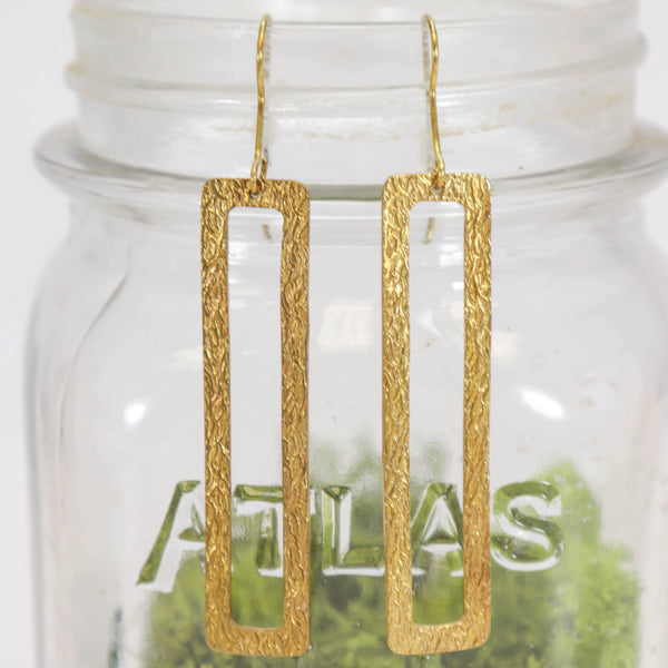 Long open rectangle hammered brass earrings