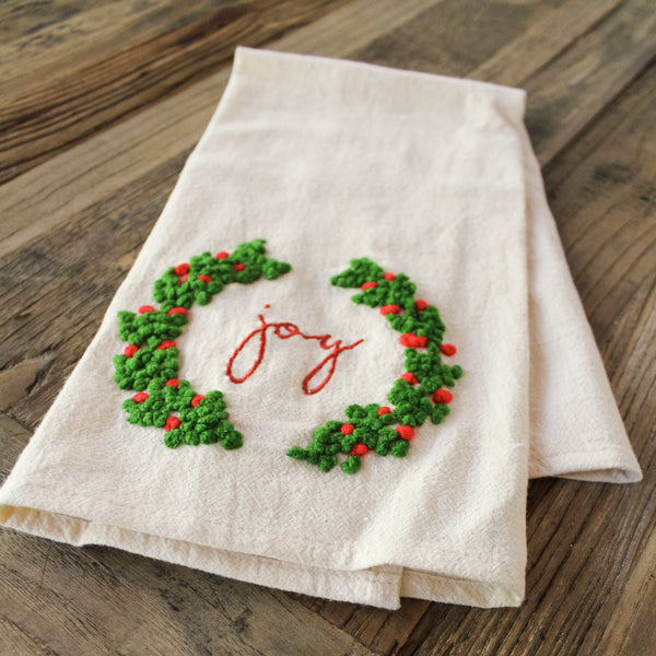 """Joy"" embroidered towel"