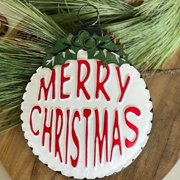 "Round ""Merry Christmas"" sign"