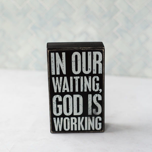 """God is Working"" box sign"