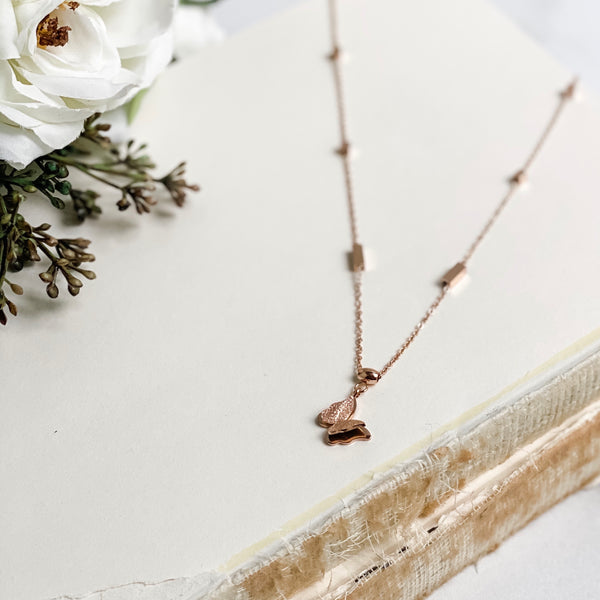 Rose gold necklace with raised butterfly charm, stainless steel