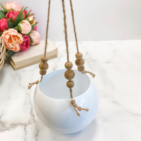 Round white metal hanging basket with wooden beads