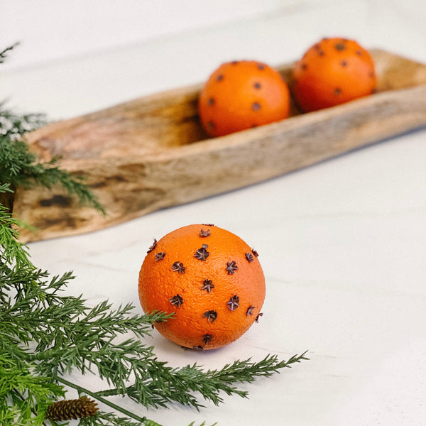 Decorative oranges with cloves, set of three