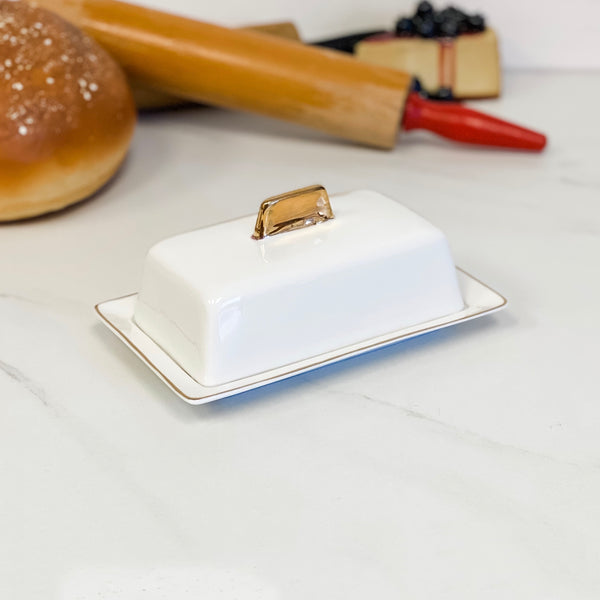 White and gold butter dish