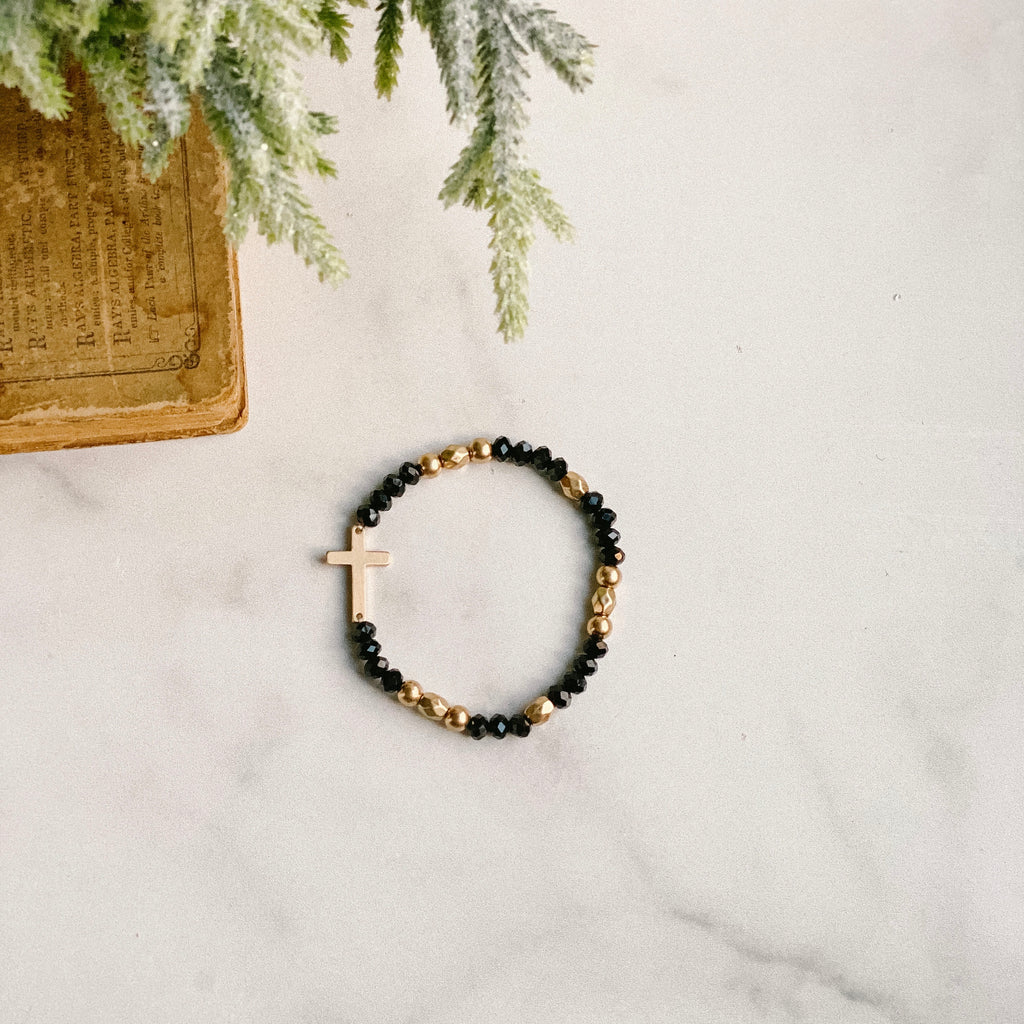 Black and gold beaded stretch bracelet with cross