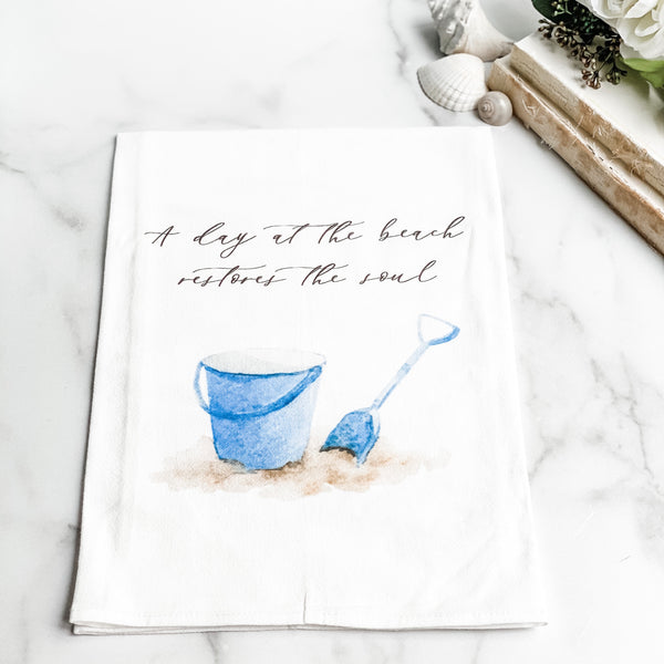 """A day at the Beach"" tea towel"