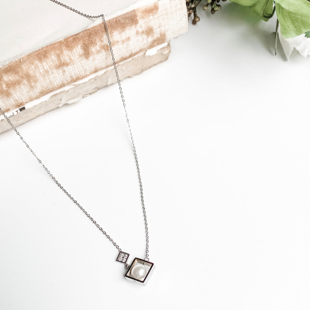 Silver necklace with pearl inside open square charm, stainless steel