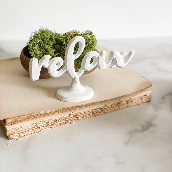 """Relax"" white metal sign"