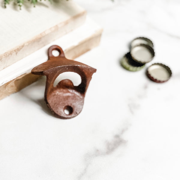 Mounted rusty bottle opener
