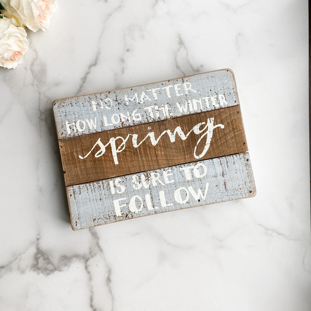 Spring is sure to follow sign