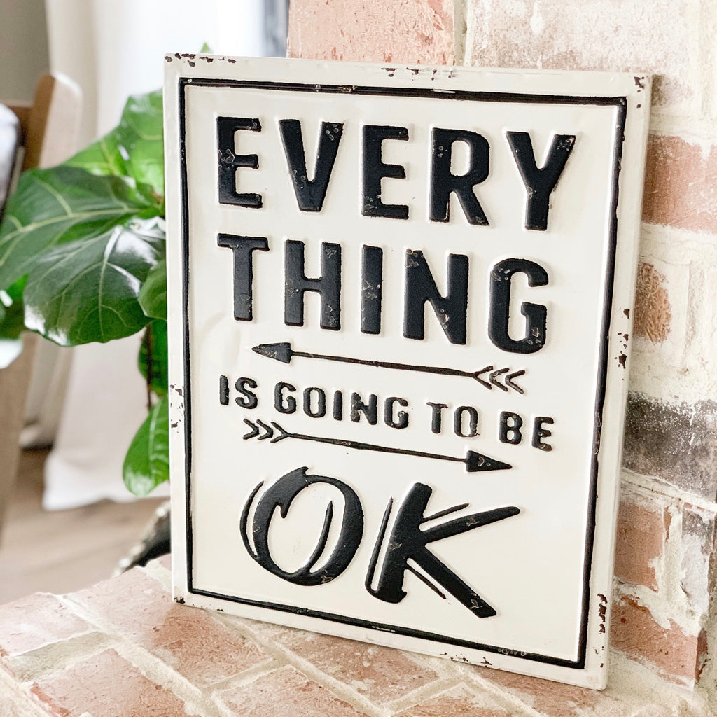 "Metal sign with quote ""Everything is going to be OK"""