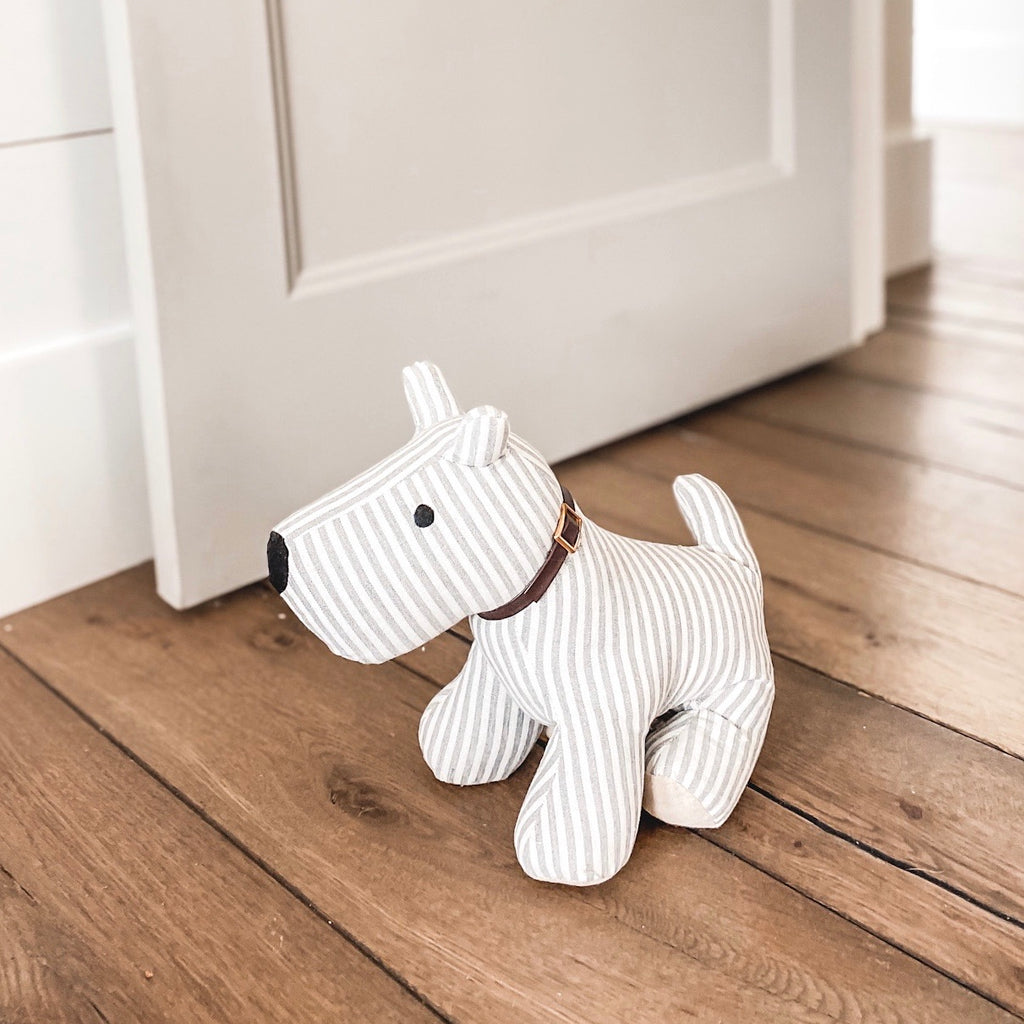 Gray and white dog door stop