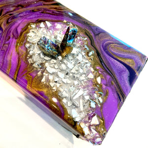 A close up of the the purple and gold geode balancing floating bottle holder