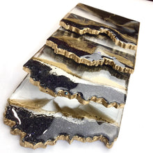 Load image into Gallery viewer, Black lava geode coasters as if an obsidiant rock with gold accents