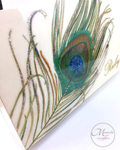 Load image into Gallery viewer, Close up look at the decoupage peacock feather with personalization on top of box - Mamota Creative