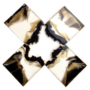Black lava geode coasters as if an obsidiant rock with gold accents