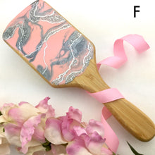 Load image into Gallery viewer, Pink and silver geode resin art on detangling spa hairbrush - Mamota Creative