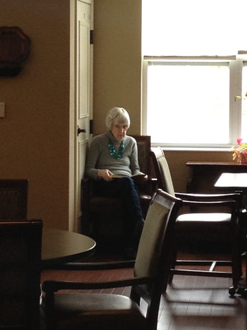 "My Mom was a big reader. Here she is ""reading"" a book in the dementia care unit."